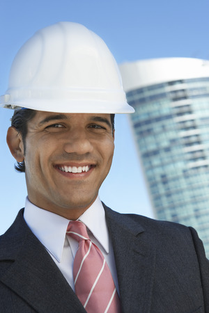 Businessman in hardhat outdoors, portrait Stock Photo - 3811400