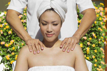 Young woman having shoulder massage at health spa Stock Photo - 3811487