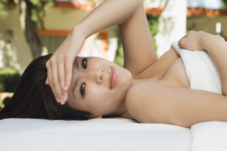 Young woman lying on massage table, outdoors, portrait Stock Photo - 3811332