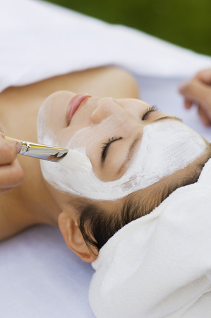 Young woman having facial treatment, close-up Stock Photo - 3811321