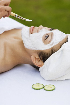 Young woman having facial treatment, close-up Stock Photo - 3811374