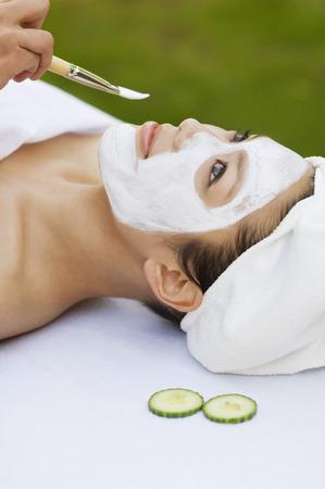 Young woman having facial treatment, close-up Stock Photo - 3811374