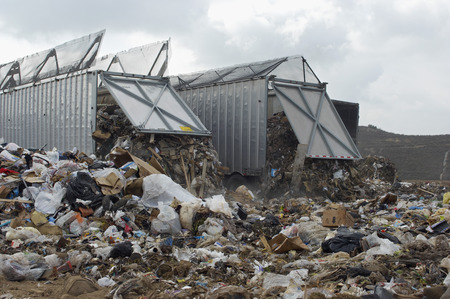 landfill site: Trucks dumping waste at landfill site