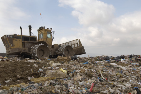 Digger working at landfill site Stock Photo - 3811511