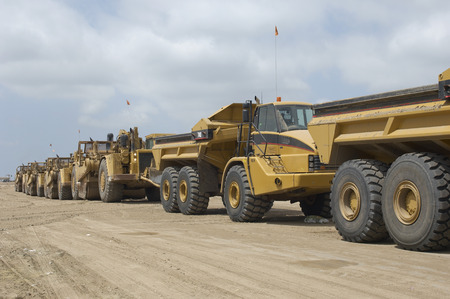 landfill site: Row of trucks at landfill site