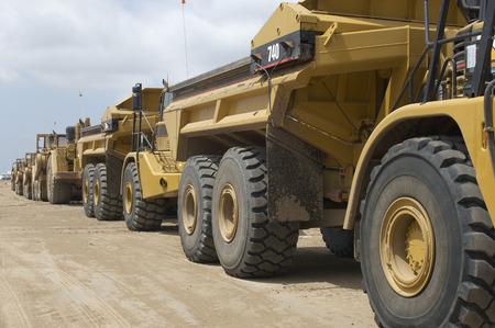 Row of trucks at landfill site Stock Photo - 3811537