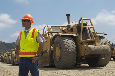 Worker walking near trucks at landfill site Stock Photo - 3811474
