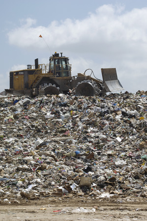Digger working at landfill site Stock Photo - 3811563