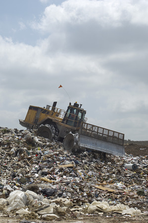 Digger working at landfill site Stock Photo - 3811538