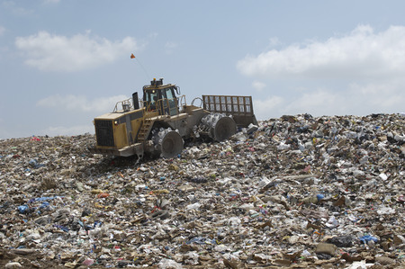 dumping: Digger working at landfill site LANG_EVOIMAGES