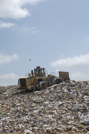 Digger working at landfill site Stock Photo - 3811542