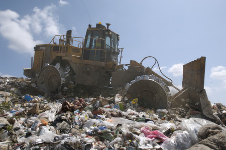 Digger working at landfill site Stock Photo - 3811521