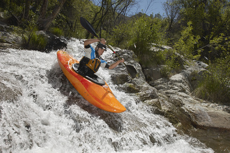 Man kayaking on mountain river Stock Photo - 3811571