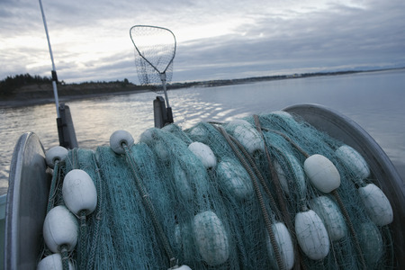 Fishing net on back of fishing boat Stock Photo