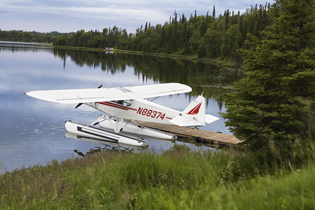 USA, Alaska, sea plane tied to pier on lake, elevated view Stock Photo - 3811527