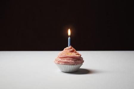 Single cupcake with birthday candle Stock Photo - 3811300
