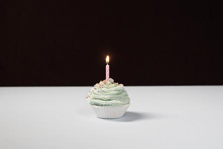 Single cupcake with birthday candle Stock Photo - 3811299