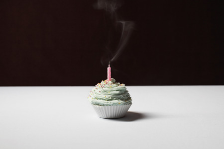 Single cupcake with blowed birthday candle Stock Photo - 3811302