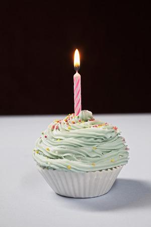 Single cupcake with birthday candle Stock Photo - 3811316