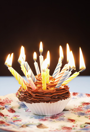 Single cupcake with birthday candles Stock Photo - 3811378