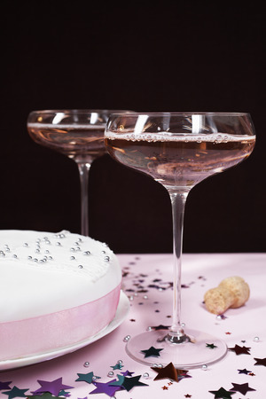Two champagne glasses and cake, close up