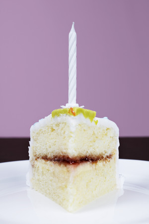 Slice of cake with birthday candle, close-up Stock Photo - 3811308