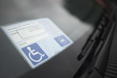 Handicap sticker on windshield Stock Photo - 3811311