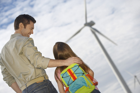 Father embracing daughter (5-6) at wind farm Stock Photo - 3811634