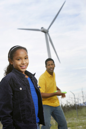 Father and daughter (7-9) playing with disc at wind farm Stock Photo - 3811592