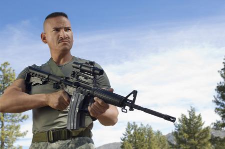 Portrait of soldier with machine gun Stock Photo - 3811608