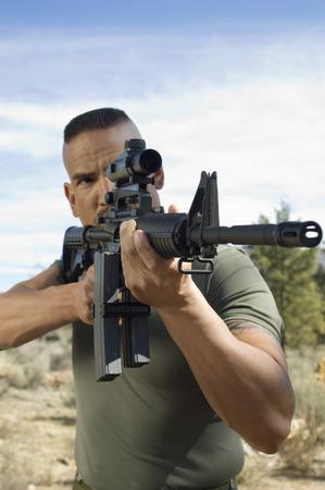 Soldier aiming machine gun Stock Photo - 3811591