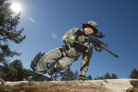 Soldier jumping over log Stock Photo - 3811709