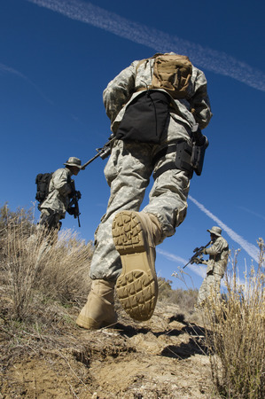 low angle views: Soldiers walking in field