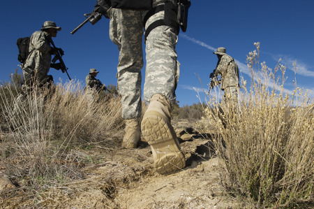 military man: Soldiers walking in desert, low section