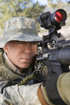 Soldier aiming machine gun, close-up Stock Photo - 3811712