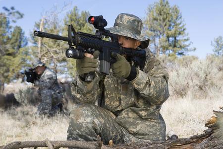 Soldier aiming machine gun Stock Photo - 3811741