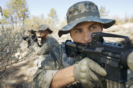 Two soldiers with weapons, close-up Stock Photo - 3811700