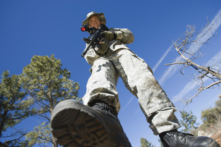 Low angle portrait of armed soldier Stock Photo - 3811688