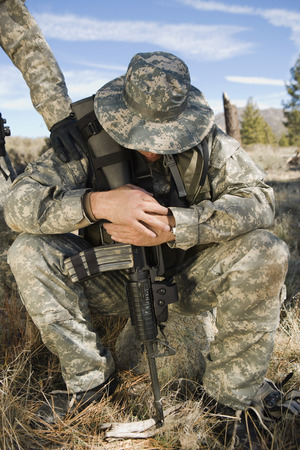 Soldier sitting, looking down Stock Photo - 3811798