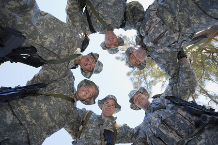 Low angle portrait of soldiers standing in circle Stock Photo - 3811783