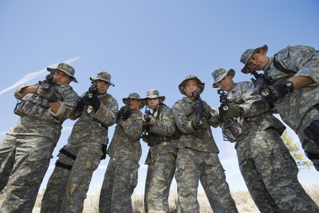 Group portrait of soldiers aiming guns Stock Photo - 3811745