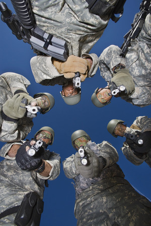 Low angle portrait of soldiers standing in circle, aiming Stock Photo - 3811785