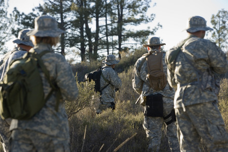 US army soldiers during training in forest, selective focus Stock Photo - 3811659