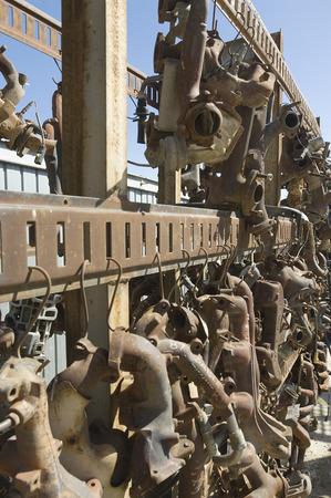 Rusty car parts on rack Stock Photo - 3811797