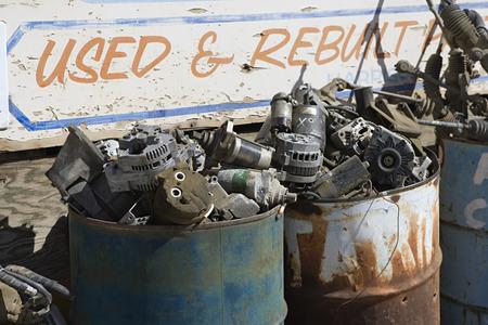 Rusty sign and barrels in junkyard Stock Photo - 3812004