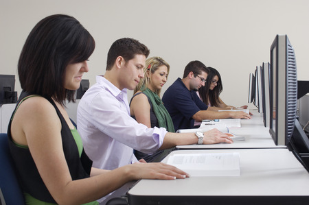 Five students working in computer classroom Stock Photo - 3811942
