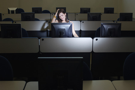 Female student with hand on head in computer classroom Stock Photo - 3812040