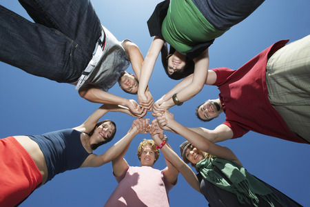 Group of young people in circle, view from below Stock Photo - 3812074