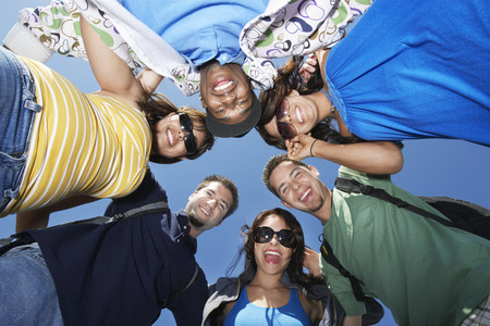 Group of young people in circle, view from below