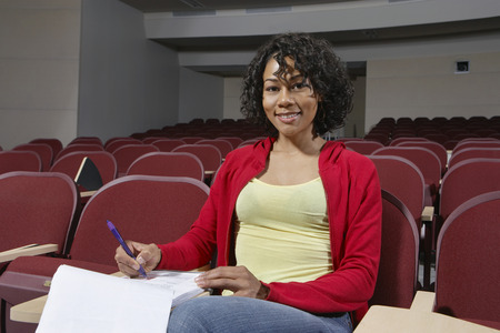Portrait of female college student lone in classroom Stock Photo - 3812106